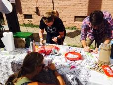 Fans making rad crafts at Girls Rock NC day party, Photo by Jennifer Bridges